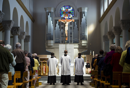 Priests stand in front of the alter while the closing song plays during the Friends Mass and Breakfast in Saint Mary's Chapel on Sunday, April 22, 2018.